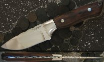 Handmade hunting knife with fileworked spine, desert ironwood handle scales and stainless hardware.