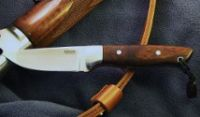 Handmade hunting knife with desert ironwood handle scales and stainless hardware.