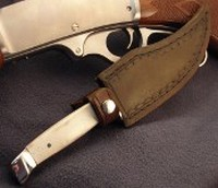 Trailing Point skinner shown in handmade leather sheath.